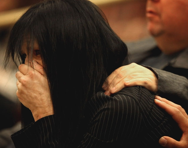 Rondha Gibson cries Thursday at the Clark County Government Center Commission Chambers during a fact-finding review into the death of her husband, Stanley LaVon Gibson. Las Vegas police fatally sh ...