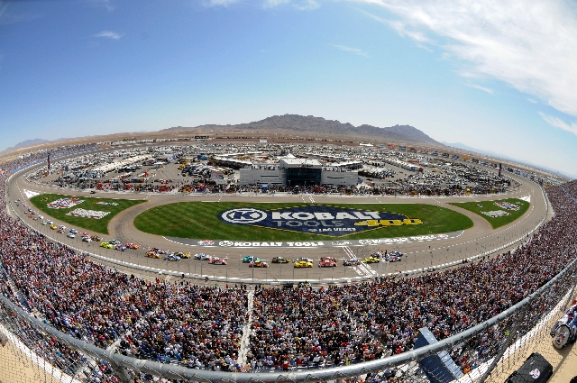Cars cross the start/finish line as the NASCAR Sprint Cup Kobalt Tools 400 gets under way in 2011 at Las Vegas Motor Speedway.
