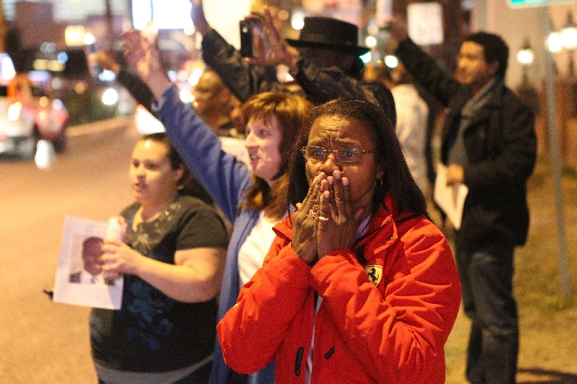 Jean Trimble-Bolden, sister of cabdriver Michael Boldon, 62, reacts as hundreds of cabbies drive with hazard lights on up Las Vegas Boulevard at Flamingo Road on Thursday as part of a vigil for he ...
