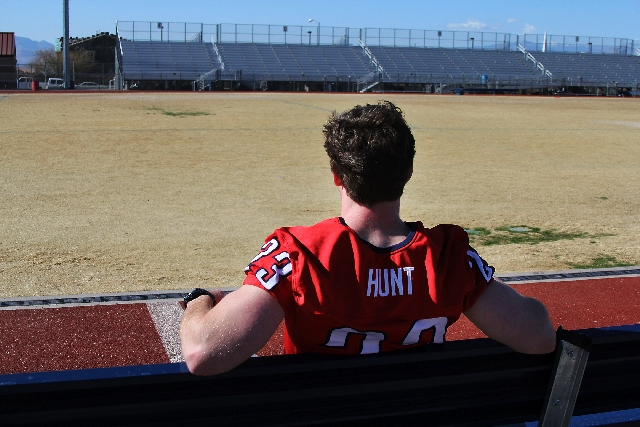 Junior Marcus Hunt sits on the sidelines of Coronado High School's football field Feb. 4. Hunt, a defensive lineman for Coronado's varsity football team, suffered a concussion during s ...