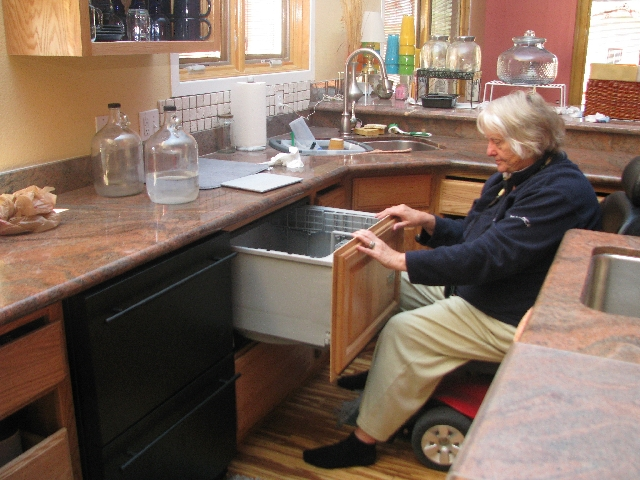 Teri Lyn Vander Heiden shows off the easily accessible drawer-like refrigerator and freezer in her Senior Smart House.