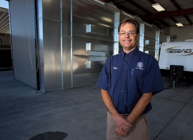 Ken Allen, service manager at Johnnie Walker RV center, poses in front of the paint booth on Feb. 26. Allen has worked at Johnnie Walker RV for nearly 30 years.