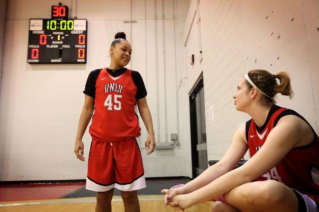 UNLV senior women's basketball player Kelli Thompson, left, chats with teammate Friederike Moderegger at the Cox Pavilion practice gym Wednesday.