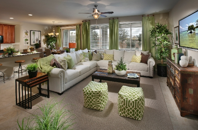 Lennar's 2,713-square-foot Carmine floor plan features a living room adjacent to the kitchen.