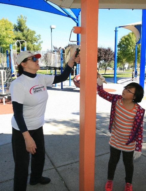 From left, Nancy Anderson and Megan Xiong paint one of the shade structures at West Flamingo Park in Spring Valley on Oct. 27, 2012, as part of Commercial Alliance Las Vegas's efforts to com ...