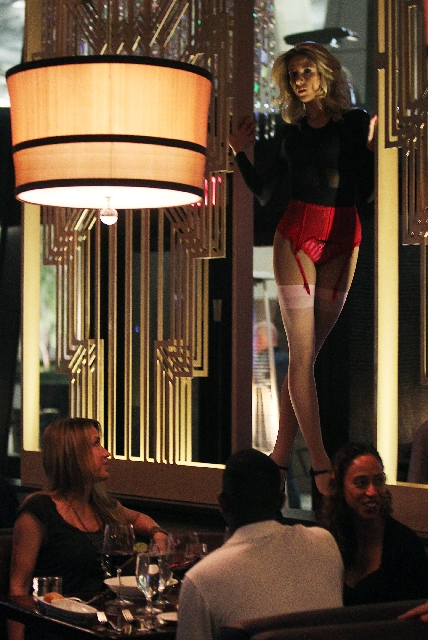 In addition to dining, SHe in Crystals at CityCenter offers entertainment in the form of a dancer/contortionist.