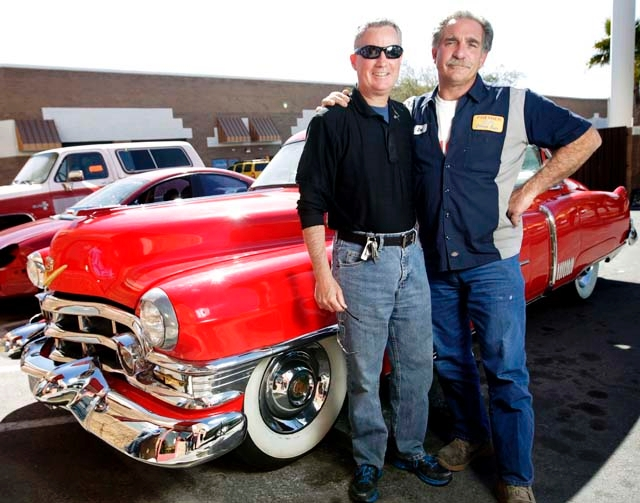 Former probation officer Mike Severance, left, and Henderson mayoral candidate Joe Scala stand in front of a 1952 Cadillac that Scala restored.  Scala, released from prison in 1996 after serving t ...