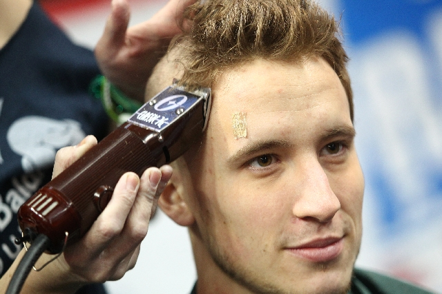 Wranglers left wing Adam Hughesman has his head shaved for charity Sunday at Orleans Arena after Las Vegas' 6-2 victory over the San Francisco Bulls. The weekend event was a fundraiser for S ...