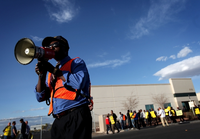 Kebere Gebrehana of Las Vegas leads cab drivers in a chant as they picket Sunday outside Yellow-Checker-Star Transportation.