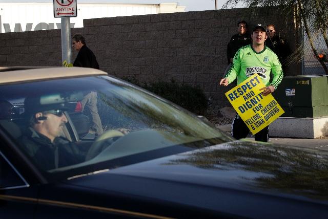 Striking cabby Julian Restrepo yells at a driver entering Yellow-Checker-Star Transportation's main yard on Sunday.