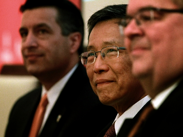 From left, Gov. Brian Sandoval, KT Lim, chairman and chief executive of Genting Group, and Paul Steelman of architects Steelman Partners meet the media during a news conference Monday. The Malaysi ...