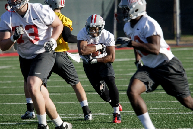 Running back Adonis Smith carries the ball Monday, the first day of spring practice on campus at UNLV. Coaches are eager to see how the junior transfer has progressed after a year idled to satisfy ...