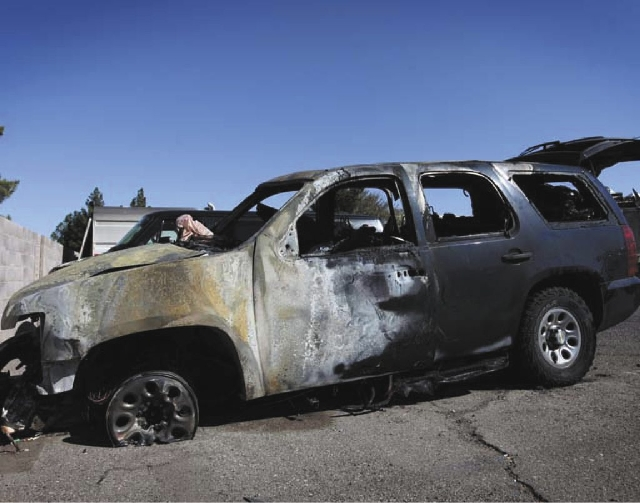 A burned-out vehicle is seen in a City of Henderson lot in Henderson on Monday.