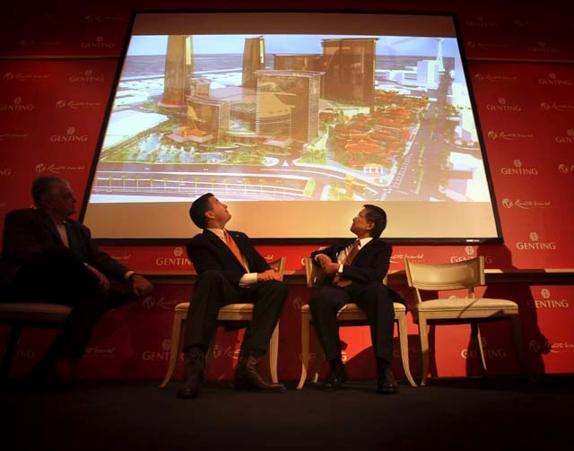 Clark County Commission Chairman Steve Sisolak, left, Gov. Brian Sandoval and KT Lim, chairman and chief executive of Genting Group, turn to observe an artist rendering of Resorts World Las Vegas  ...