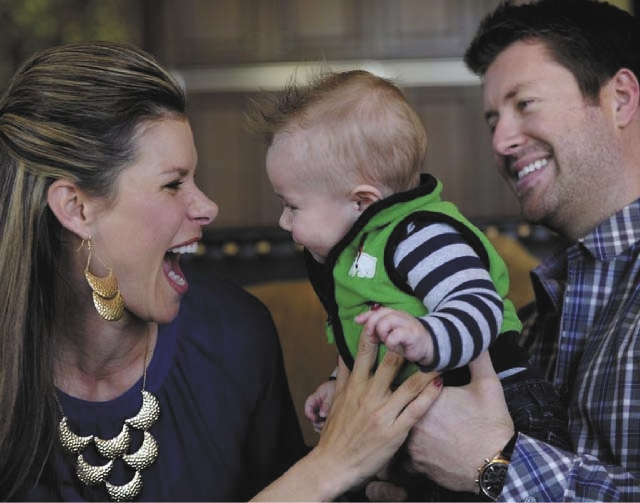 Jamie Little, left, and husband Cody Selman hold their 6-month-old son, Carter. Little, an ESPN auto racing reporter, and Selman had their son after Little covered the death of her friend, driver  ...