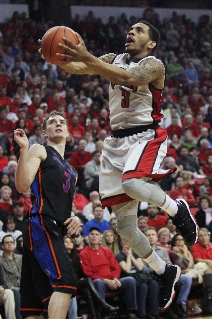 UNLV guard Anthony Marshall goes past Boise State forward Anthony Drmic for a basket in the Rebels' 68-64 win on Tuesday.