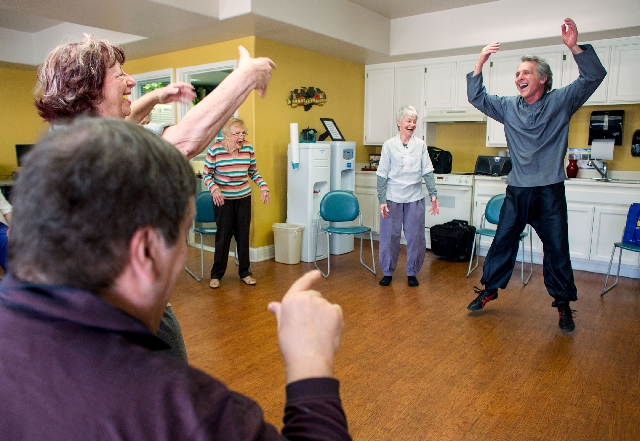 Mitch Menik, right, laughs with others during a tai chi class at Atria Sunlake, March 5. Menik, who instructs the class, said laughing fills the body with positive energy.