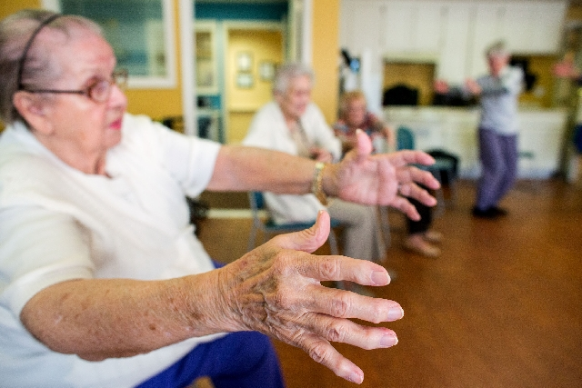 Betty Grimm takes a tai chi class at Atria Sunlake, March 5. The course is geared for people with limited mobility or who may be chair-bound.