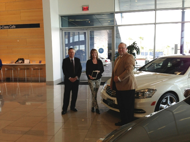 Butch Jacobs, Left, Mercedes Benz Of Henderson General Service Manager,  Congratulates Prize