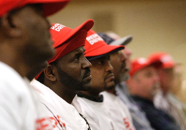 Taxi driver Tewodros Mekonen listens during a March 7 membership meeting, at the Gold Coast Hotel and Casino, of Yellow-Checker-Star Transportation taxi drivers who are on strike.