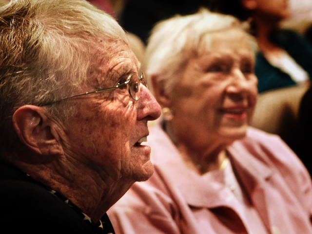 World War II veterans, from left, Billie D'Entremont, 93, and Evie Hallas, 90, listen while being honored at Veterans Court graduation March 7 in the Henderson Municipal Court.
