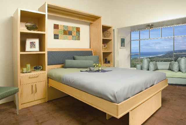 Multifunctional pieces, such as this wall bed, are ideal for small spaces, including lofts.