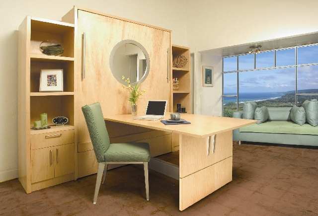 Wall beds, such as this unit from Inova, offer storage, a desk or table as well as a place to sleep.