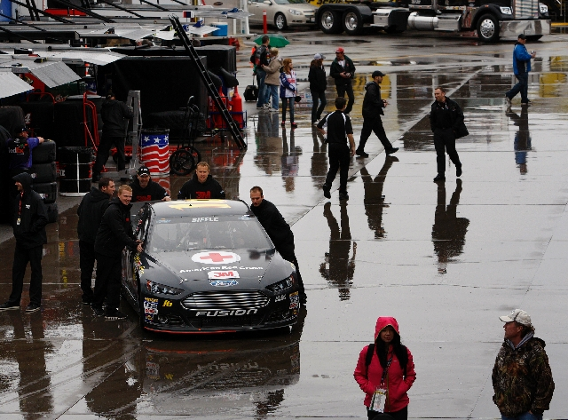 Greg Biffle's crew pushes his car through Las Vegas Motor Speedway's garage area Friday. Rain caused the cancellation of Sprint Cup qualifying.