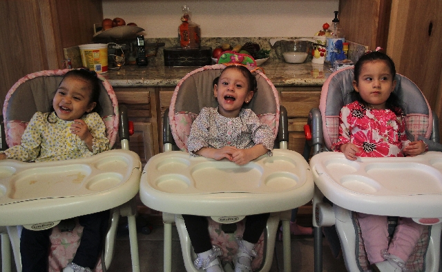 Delia, from left, Sandra and Sophia Lazo smile and laugh in their home in Las Vegas.