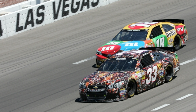 Landon Cassill (33) and Kyle Busch race closely through the front stretch Sunday. Busch, who finished fourth, was less forthcoming about NASCAR's new Generation-6 car than other drivers, inc ...