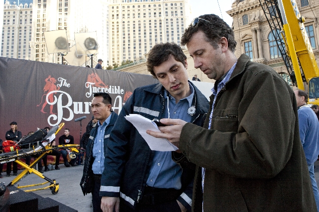 """Screenwriters John Francis Daley, left, and Jonathan Goldstein prepare for a scene as """"The Incredible Burt Wonderstone"""" films on the Strip."""