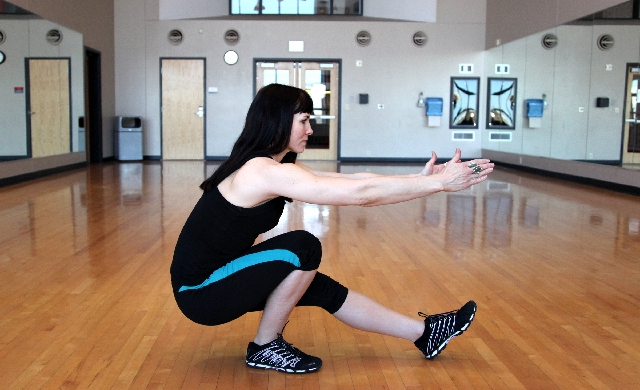 PISTOL SQUATS, ACTION: Hinging at the hip first, descend into a squat so the crease of the hip is below the knee. Contracting the glutes, return to the starting position. Perfo ...