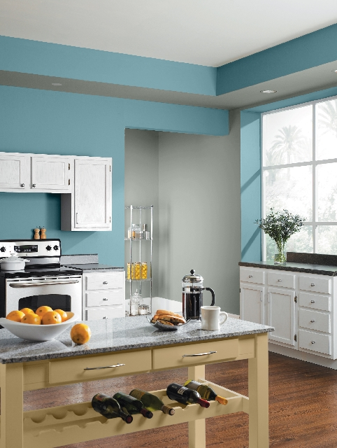 A light blue pairs with white to give this kitchen an open and breezy feeling.