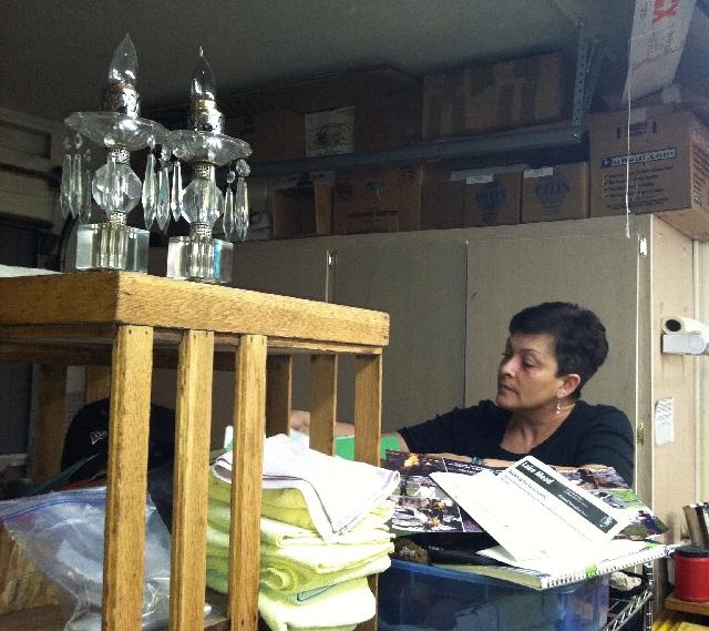 Professional organizer Christine Ruggiero goes through a client's garage storage bins.