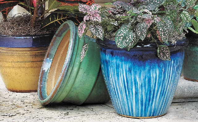 Add a touch of blue to your décor with accessories, such as this Malaysian pottery from Tuesday Morning.