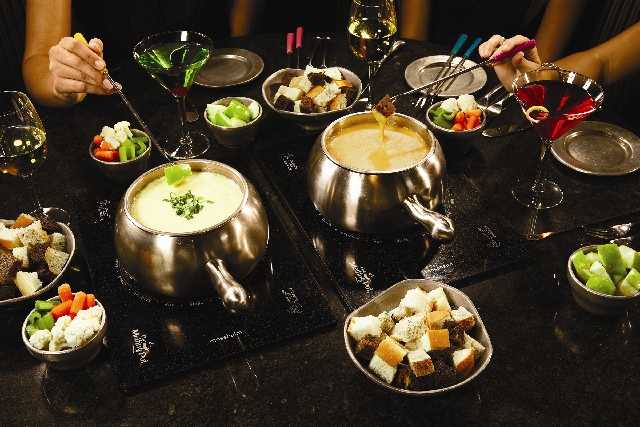 Different types of fondue are pictured at The Melting Pot restaurant at 8704 W. Charleston Blvd. The franchise has changed its menu to accommodate the budget diner.