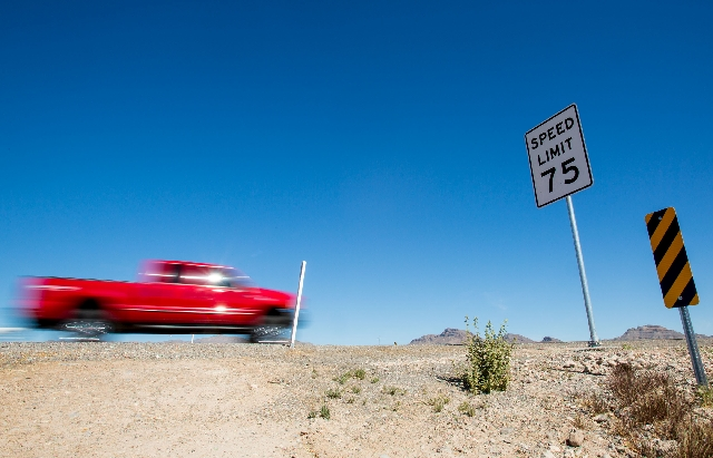 A truck passes a 75 mph sign Wednesday on Interstate 15 near the Las Vegas Motor Speedway. Lawmakers are considering raising limits.