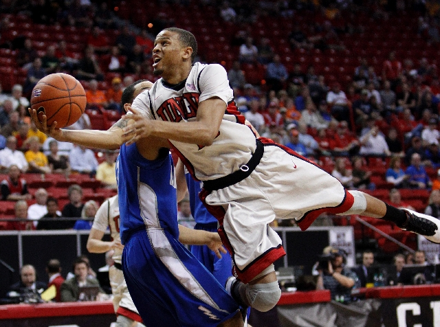 Bryce Dejean-Jones of UNLV scores against Air Force during a quarterfinal game in the Mountain West tournament at the Thomas & Mack Center Wednesday.