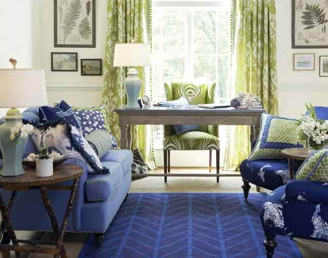 Blue, in all its various incarnations, is a hot trend in home decorating. Deep, rich blues, such as those on the chairs and rug, help energize this space.