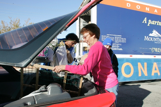 Carol Bellomy drops off her fifth load of clothing donations to the Goodwill donation trailer in the parking lot of MountainView Hospital, 3100 N. Tenaya Way, Dec. 3, 2009.