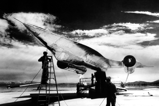 Workers position a mock-up of the United States' first stealth plane, the A-12, on a pole at Area 51 for radar signature testing in 1960. The model of the reconnaissance aircraft had to be p ...