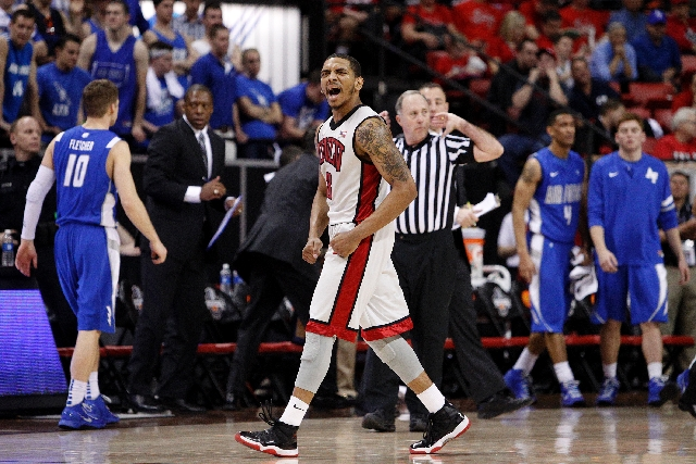 Anthony Marshall of UNLV celebrates as his team leads Air Force during the quarterfinal game in the Mountain West tournament at the Thomas & Mack Center Wednesday.