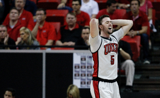 Katin Reinhardt of UNLV reacts after he was called for a foul against Air Force during the quarterfinal game in the Mountain West tournament at the Thomas & Mack Center Wednesday.