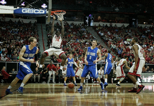 UNLV forward Anthony Bennett descends after dunking between Air Force forwards Marek Olesinski (0) and Mike Fitzgerald, left, during the third-seeded Rebels' 72-56 win in a Mountain West tou ...