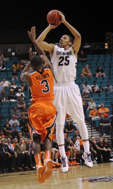 Colorado guard Spencer Dinwiddie lines up a shot against Oregon State guard Ahmad Starks in the Buffaloes' 74-68 win Wednesday. Dinwiddie scored 20 points.