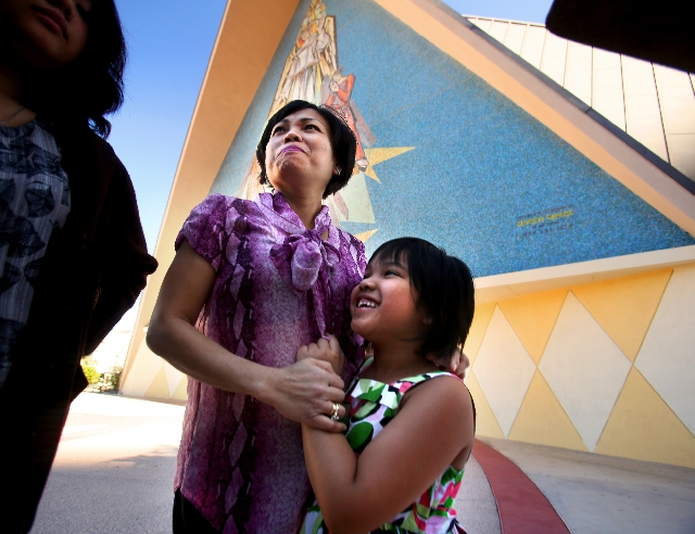 Coloradoans Rumondang Parapat, left, and daughter Rosary Thomas, 7, visited the Mass on Wednesday at Las Vegas' Guardian Angel Cathedral to celebrate the new pope.