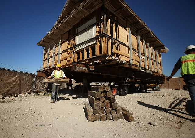 Gordon Hyatt removes blocks before moving a house Wednesday at Springs Preserve in Las Vegas. The historic cottage was moved a half-mile within Springs Preserve during restoration of four structur ...