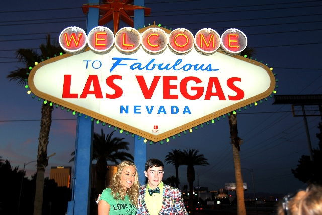 """Kathryn Thomas, Irish TV host of """"The Voice of Ireland,"""" left, poses with Irish boxer Brian Reynolds at the Welcome to Fabulous Las Vegas sign on Wednesday. The Las Vegas Convention an ..."""