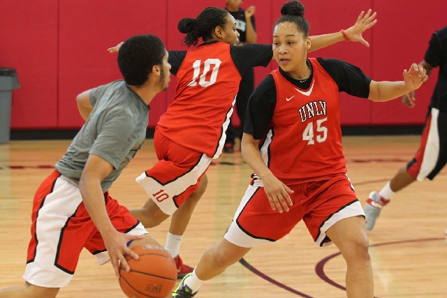 UNLV guard Kelli Thompson (45) and forward Rejane Verin (10) run through defensive drills Tuesday ahead of the Lady Rebels' Mountain West tournament quarterfinal today against New Mexico.