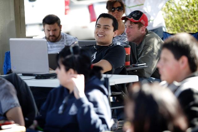 Jose Navarro of Las Vegas, an investor's representative, places a bid Thursday during an auction at Nevada Legal News in Las Vegas.